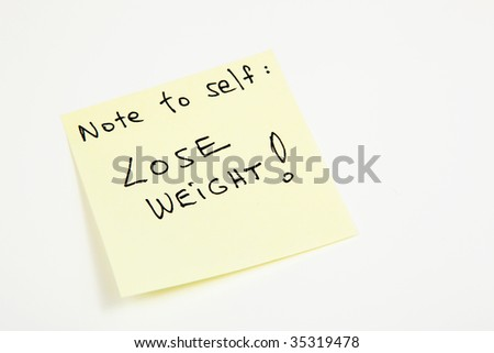 Yellow sticky note to self reminding to lose weight