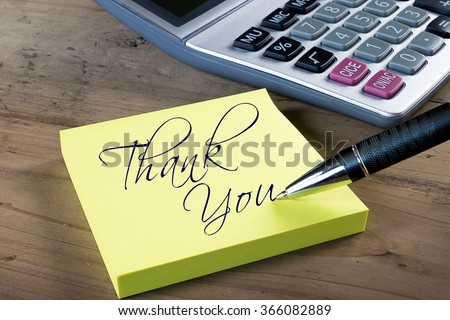 "Yellow sticky note with ""Thank you"" written with pen. Administrative Professionals or Secretaries day concept. - stock photo"