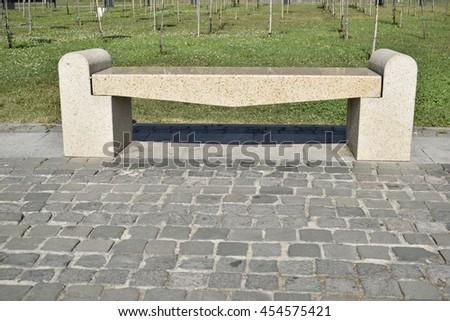 yellow stone bench - stock photo