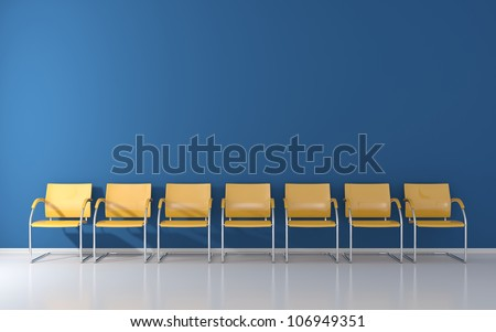 Yellow stools in the waiting room - stock photo