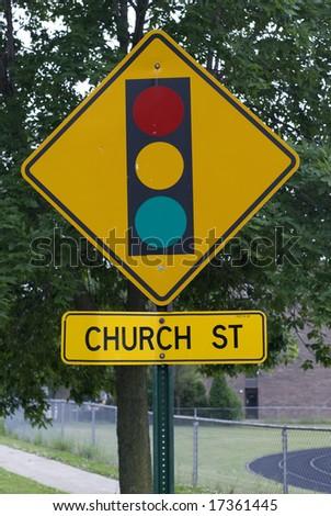 Yellow stoplight street sign - stock photo