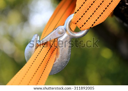 Yellow strap and steel hook - stock photo