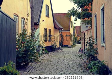 Yellow street in village in Denmark - stock photo