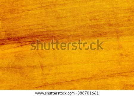 yellow striped fabric as background - stock photo