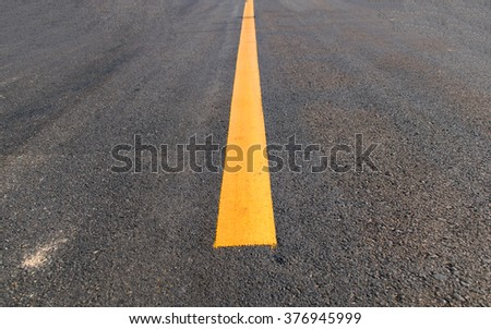Yellow stripes mark the center of the road