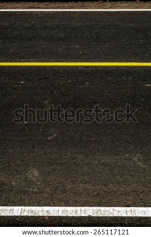 Yellow stripes on the road as a background