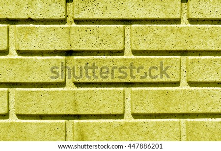 Yellow stylized brick wall texture. Background and texture for design. - stock photo