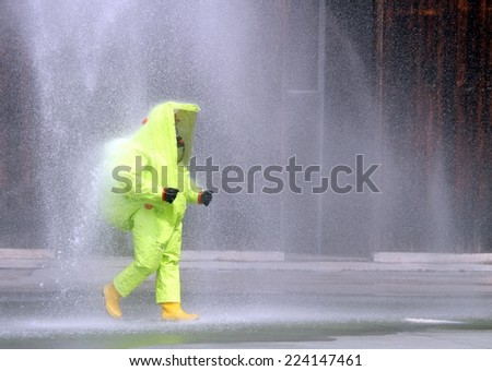 yellow suit protective radiation defense against biological warfare - stock photo