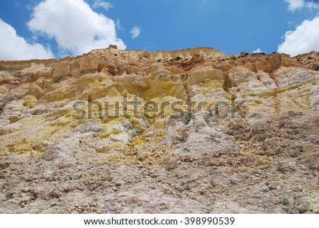 Yellow sulphur crystals on the wall of the Stefanos volcano crater on the Greek island of Nisyros. The popular tourist attraction is still active and kept under close monitoring.