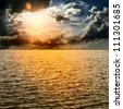 Yellow Sun Set in The Middle of The Ocean - stock photo