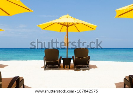 Yellow sun umbrellas and beach chairs on beach,boracay,Philippines - stock photo