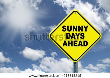 Yellow Sunny Days Ahead cautionary road sign - stock photo