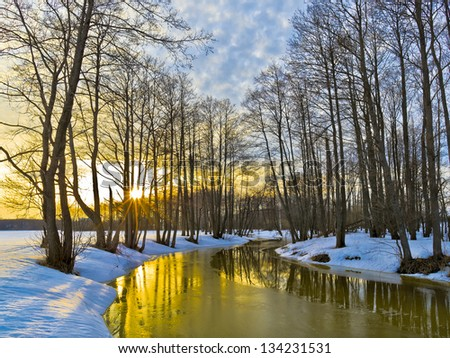 Yellow sunset in early spring. River Sukhodrev. Kaluga region. Russia - stock photo