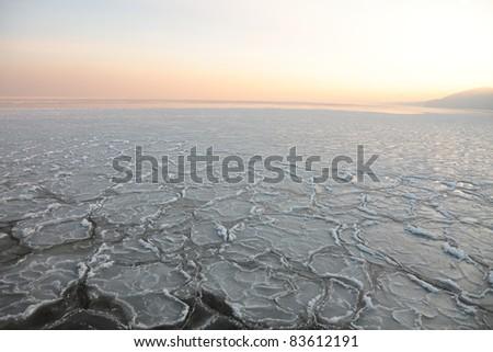 yellow Sunset on the sea - ice - floe. Poland, Gdynia - stock photo