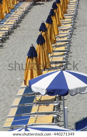 Yellow Sunshades Monterosso al Mare Beach , town in famous Cinque Terre, Ligurian sea Italy - stock photo