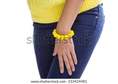 yellow sweater and accessory in the form of a bracelet isolated