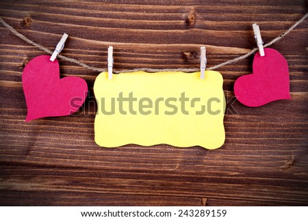 Yellow Tag Or Label With Two Hearts On A Line With Copy Space Or Your Free Text Here On Wooden Background, Two Symbols, Vintage, Retro And Old Fashion Style With Frame - stock photo