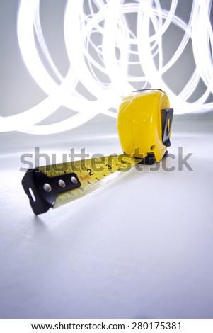 Yellow tape measure light streaks stock photo royalty free yellow tape measure with light streaks aloadofball Images
