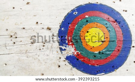 yellow target in archery target on white wood - stock photo