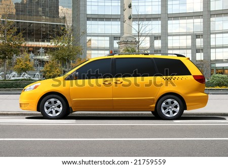 Yellow taxi car in the city - stock photo