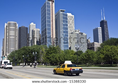 Yellow taxi in downtown Chicago, IL. - stock photo