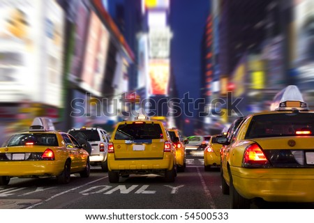 Yellow Taxi in Time Square, New York City - stock photo