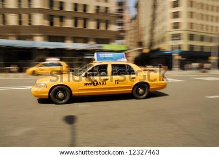 Yellow Taxi rushing  through New York City - stock photo