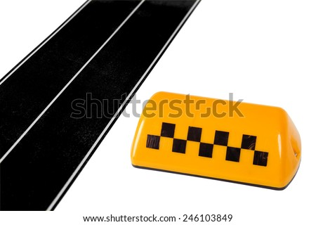 Yellow taxi sign and model of the road. Texture, background, concept - stock photo