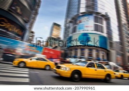 Yellow taxis in the streets of Manhattan, New York City, USA - stock photo