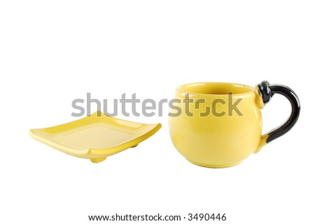 yellow tea cup and saucer