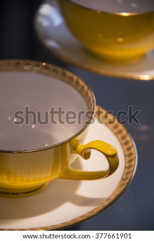Yellow Teacups - stock photo
