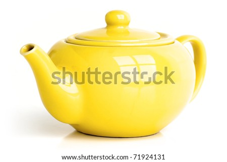 Yellow teapot isolated on white. - stock photo