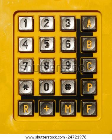 Yellow telephone keypad - stock photo