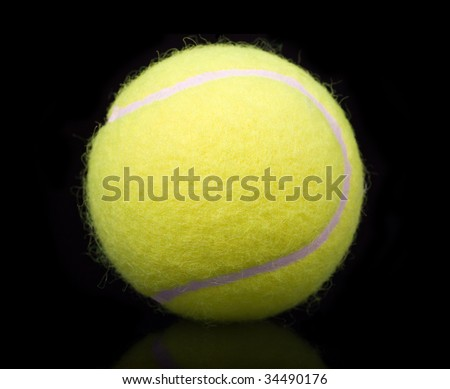 yellow tennis ball isolated on black background