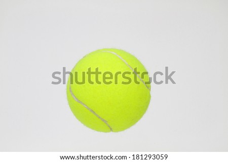 Yellow tennis ball on white background