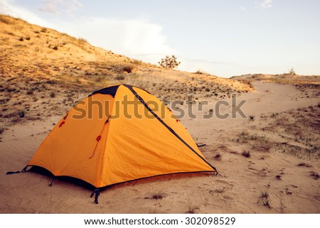 Yellow tent in the desert sands, a great place for what would have to sleep in silence. Hottest places on the planet - stock photo