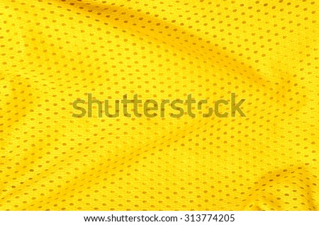 Yellow textile pattern as a background. Close up on yellow material with holes texture on fabric. - stock photo