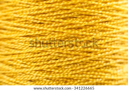 yellow thread Nylon rope macro background - stock photo