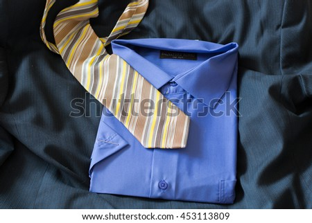 Yellow tie and blue shirt - stock photo