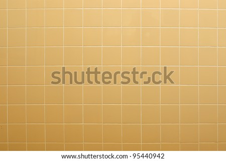 Yellow tiles wall textured background
