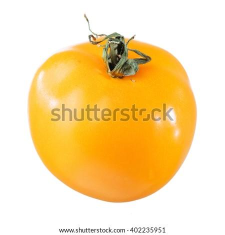 yellow tomato isolated on white - stock photo