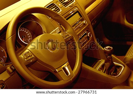 yellow toned interior of a modern car - stock photo