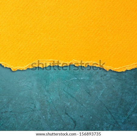 yellow torn paper over blue background