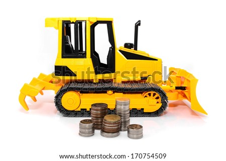 Yellow toy bulldozer and coins isolated over white background