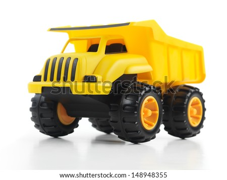 Yellow toy dump truck isolated on white background - stock photo