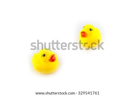 yellow toy rubber duckling isolated on white background - stock photo