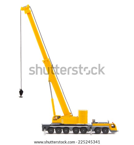 yellow toy truck crane isolated over white backgroung - stock photo