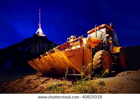 Yellow tractor on night sky - stock photo