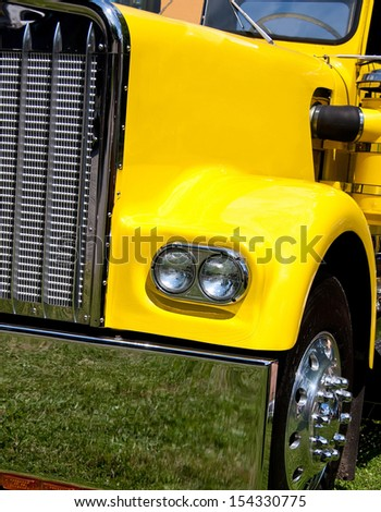 yellow tractor trailer closeup