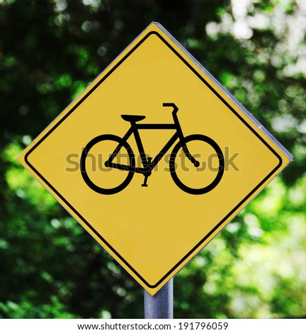 Yellow traffic label with bycicle pictogram - stock photo